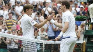 Andy Murray shakes hands with David Goffin at the net