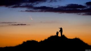 Father and son watching a comet in Massachusetts.