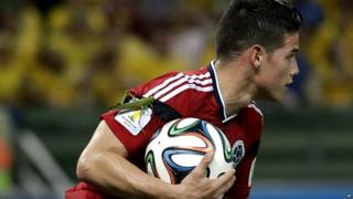 A large insect lands on the arm of Colombia's James Rodriguez
