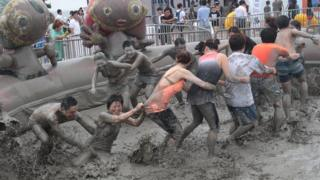 People in mud pit