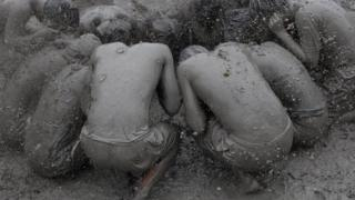 People covered in mud
