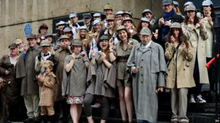 People dressed as Sherlock Holmes character