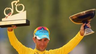 Vincenzo Nibali of Italy and Astana Pro Team celebrates victory in the yellow jersey on the podium
