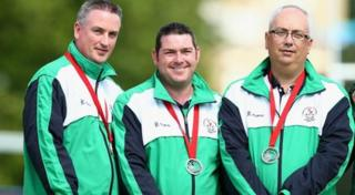 Northern Ireland triples lawn bowls team wearing their silver medals