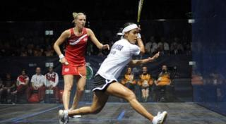 Squash player hits a shot in ladies singles final