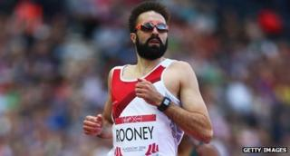Athlete Martyn Rooney as he finishes a race