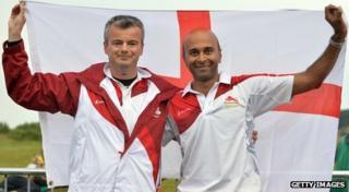 David Luckman and Parag Patel hold aloft the St George's flag