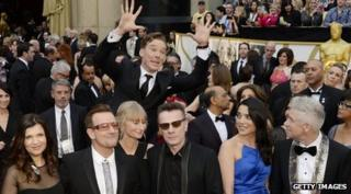 Benedict Cumberbatch photobombs U2