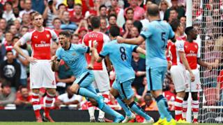 Martin Demichelis scores against Arsenal.