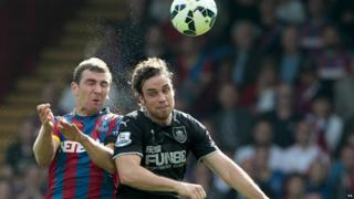 Crystal Palace's James McArthur and Burnley's Michael Duff battle for the ball during the Barclays Premier League match at Selhurst Park