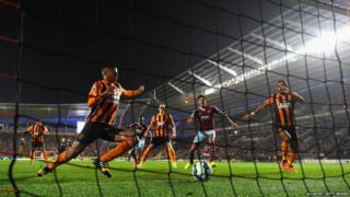 Hull defender Curtis Davies diverts the ball into his own net for the second West Ham goal during the Barclays Premier League match between Hull City and West Ham United at KC Stadium