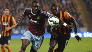 Guy Demel is challenged by Hull City's Mohamed Diame during their English Premier League soccer match at the KC Stadium in Hull