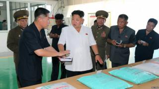 Kim Jong-un provides guidance during his visit to the Chollima Tile Factory