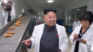 Kim Jong-un in a food factory.