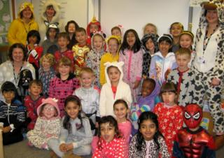 A group of children in onesies
