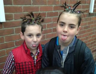 Boys with loom bands in their hair