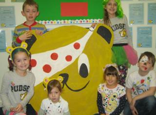 Children with a Pudsey bear face