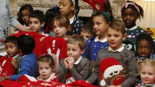 Children wearing Christmas jumpers