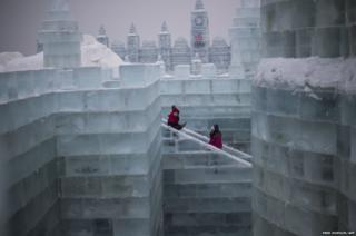 Visitors walks in an ice castle