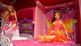 Barbie dolls are displayed at the DreamToys toy fair in central London, on November 5, 2014.