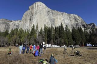 Spectators gaze at El Capitan for a glimpse of climbers Tommy Caldwell and Kevin Jorgeson
