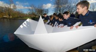 Children launch the boat