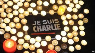 Je Suis Charlie message surrounded by candles