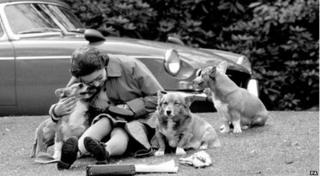 The Queen with her corgis at Virginia Water watching competitors, including Prince Philip in the marathon of the European Driving Championship, part of the Royal Windsor Horse Show, in 1973