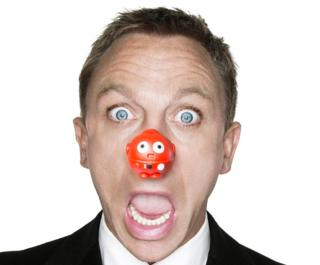 Daniel Craig wearing a red nose