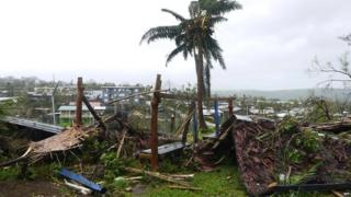 Flattened structures and debris, caused by Cyclone Pam