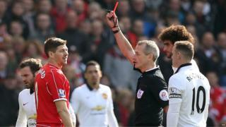Steven Gerrard is shown the red card by referee Martin Atkinson