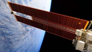 Image released April 14, 2015 by ESA/NASA shows the giant solar arrays on the International Space Station photographed on February 12, 2015 by Expedition 43 Flight Engineer Samantha Cristoforetti of the European Space Agency (ESA).