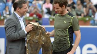 Andy Murray being handed lederhosen trousers