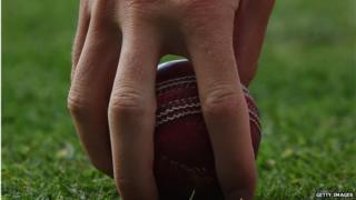 Cricketer with a cricket ball