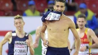 French steeplechaser Mahiedine Mekhissi-Benabbad removes his vest