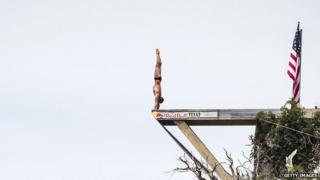 Artem Silchenko of Russia prepares to dive from the 27 metre platform
