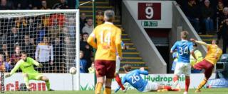 Lionel Ainsworth (right) fires in the second goal for Motherwell