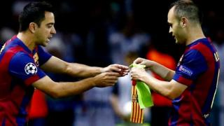 "Barcelona""s Andres Iniesta hands over the captain""s armband as he is substituted by Xavi"