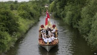 The Royal Barge Gloriana on the River Thames passes through Old Windsor Lock to mark the 800th anniversary of the sealing of the Magna Carta