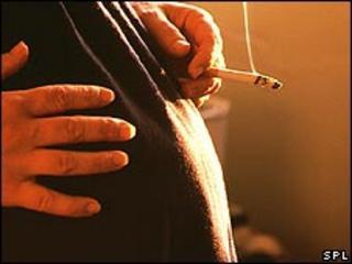 A pregnant woman smoking