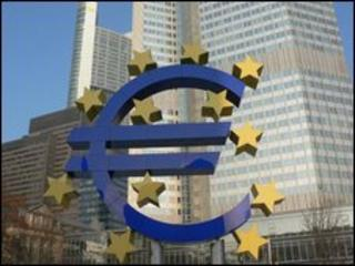 Euro currency logo sign in front of ECB building in Frankfurt