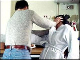 A man beating a woman