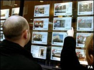 Looking in an estate agent's window