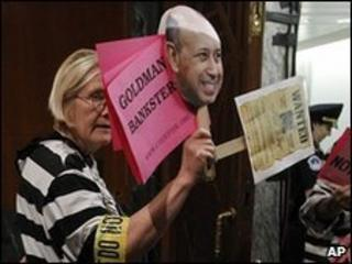 A protester at a Senate hearing on Goldman Sachs