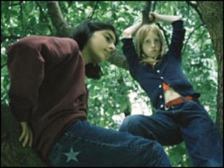 Girls climbing a tree