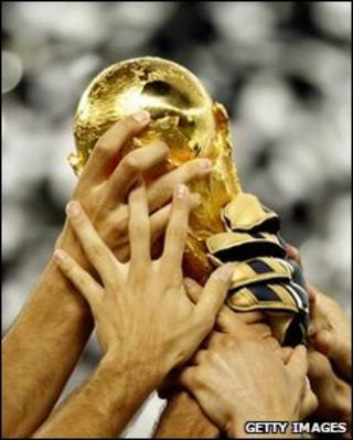 Players holding Fifa World Cup