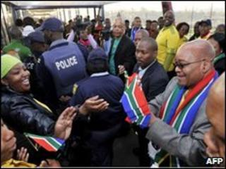 President Jacob Zuma hands out flags ahead of World Cup