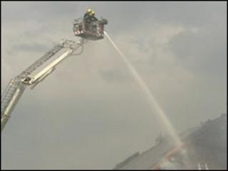 Firefighters tackle the blaze