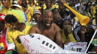Fans at the re-opening of the showpiece Soccer City stadium in Johannesburg