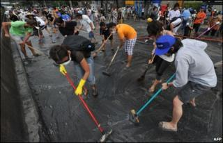 People cleaning the streets